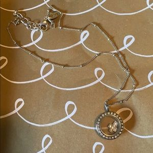 Silver charm case necklace